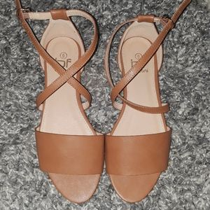 Open toed light brown flats